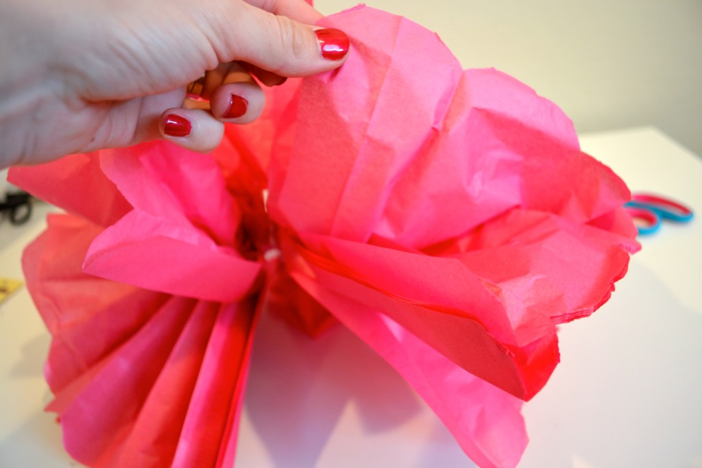 how many pieces of tissue paper to make pom poms How to make tissue paper pom poms  my preparations for my cousin's recent wedding included stalking many  you can cut the pieces to make smaller pom poms].